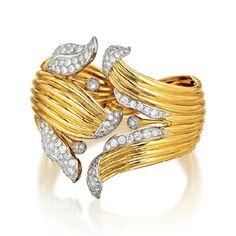 Verdura's diamond, platinum, and gold Lily Bracelet, originally created for Marlene Dietrich. Diamond Bangle, Diamond Jewellery, Fantasy Jewelry, Sea Glass Jewelry, Crystal Jewelry, Bling Jewelry, Jewelry Box, Jewlery, Jewelry Armoire