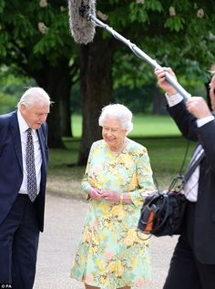 Sharing a joke: The Queen chats with Sir David Attenborough in the first picture from the ...