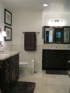 In this bathroom, tan/beige is dominant, with pale gray walls and dark gray towels.The granite is a mix of both grays and tans and there are white accents in the molding, beadboard wainscoating and mats for the artwork. Blue Bathroom Decor, Grey Bathrooms, Beige Bathroom, Bathroom Accents, Bathroom Colors, Bathroom Wall, Bathroom Accessories, Master Bathroom, Bathroom Ideas
