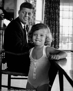 JFK with Caroline, such a cute little smile