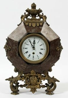 905: Abgängig mantel clock with a sculpture of a young : Lot 905