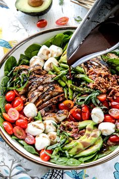 Grilled Caprese Chicken Salad with the most incredible balsamic marinated chicken, fresh tomatoes, melt in your mouth mozzarella, grilled asparagus, creamy avocado and crispy bacon all drizzled with Creamy Balsamic Reduction Dressing =  Out of this world!
