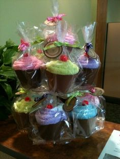 spa sock cupcakes!  FUN!    so cute, i could do the hair turbans, or the spa body wraps in it!