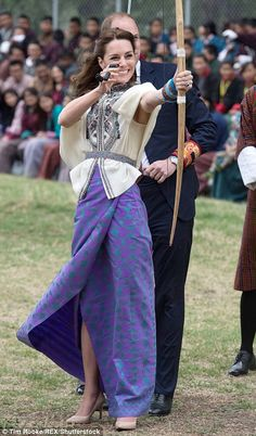 Taking aim: The Duchess of Cambridge tries her hand at archery, Bhutan's national sport, on the royal couple's visit to the kingdom - 14/04/2016