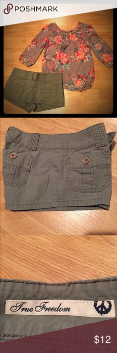 Junior shorts and polyester blouse. Military green shorts, hardly worn and ARIZONA Jean Co. rose print polyester blouse size (XS), hardly worn as well. Clothe in great condition. True Freedom Shorts Cargos