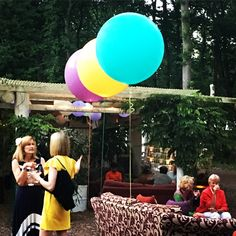 Giant balloons in bright pop colours for outside wedding party in the woods near Andover, Hampshire
