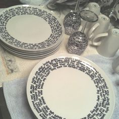 DIY Dish Set: Did this today and LOVE the results! Buy plain dishes from the dollar store and decorate to suit with sharpie. Place in the oven at 350 for 30 mins and it's permanent! -- I used all black and white and wrote song lyrics on plates and cute coffee sayings on my mugs!