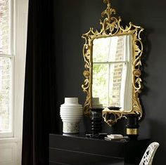 i love ornate frames, mirrors, and the white/black/gold!!