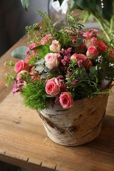 Birch Aspen bark containers with a sweet pink spray rose with trick dianthis arrangement / http://www.deerpearlflowers.com/rustic-wedding-centerpieces-with-bark-container/