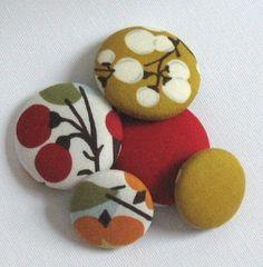 Fabric button refridgerator magnets.