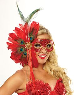 Make a bold and confident statement at your next masquerade in our Spanish Peacock Feather Mask. An ideal accessory for a number of events, this eye mask goes great with Mardi Gras, Carnival and Parades. Our Spanish Peacock Feather Mask features a red sequin eye mask with jeweled forehead and gold braided trim, fanning of red and peacock feathers at one side and accented with a gold rosette embellishment with streamers of red ribbon and strands of gold beads.