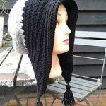 http://www.ravelry.com/patterns/library/winter-bonnet-with-tassels