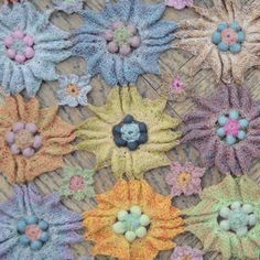 A field of flowers: large hand crocheted flowers in multiple colours embellish this wonderful 100% linen scarf (Yvette) from French designer Sophie Digard