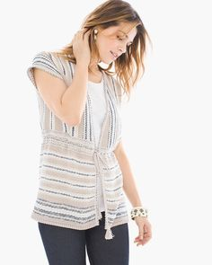 "Sunny days can have their cozy moments, too. This short-sleeve cardigan is the perfect throw-and-go layer for warmer months ahead (A/C extremes and all), woven in stylish directional stripes and finished with a tasseled tie waist.  Tie closure.  Regular length: 27.25"".  Petite length: 26"".  Cotton, acrylic, nylon and polyester.  Machine wash. Imported."