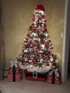 This is a great tip use a Rubbermaid container to put your Christmas tree in. Set up beautifully!