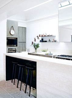 House tour: a stately Melbourne home refreshed with a striking palette: The colour palette in the kitchen is somewhat subdued.