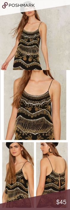 Nasty Gal Bead of My Heart Beaded Tank S No trades, only selling. Can you feel it? The Bead of My Heart Top comes in black and features multicolor metallic beading throughout, cropped cami silhouette with scalloped hem, thin shoulder straps, back button closure, and beaded fringe detail at hem. By Nasty Gal.  *Content  100% Polyester  *Dry clean  *Imported Tops Tank Tops