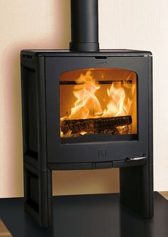 Our wood stove...love the Scandinavian minimalist design:)