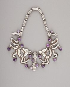 "Necklace | William Spratling.  ""Double Jaguar"".  Silver and amethyst.  ca. 1940"