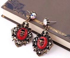 BETSEY JOHNSON SKULL EARRINGS WITH BOW - ANTIQUE BRONZE WITH RED