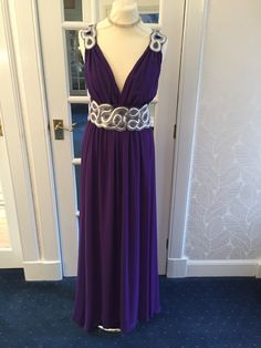 Purple chiffon with silver detail waist and shoulder. Ideal for a size 16. Plunging neckline which can be pinned if too revealing