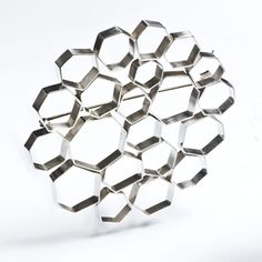 "Cell Brooch   In bright sterling silver. 3"" in diameter.   Exhibit: Featured Artist: Alisa Miller   http://www.facerejewelryart.com/artist.php?id=28"