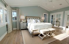 Guest bedroom Steely light blue bedroom walls, wide-plank rustic wood floors, patterned curtains, lots of light, vaulted planked ceiling. Blue Bedroom Walls, Bedroom Orange, Bedroom Wall Colors, Home Bedroom, Bedroom Decor, Bedroom Ideas, Grey Walls, Bedroom Wood Floor, Bedroom Retreat