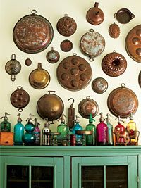 Collection of old copper cookware and colorful bottles of all shapes and sizes makes interesting eye candy.