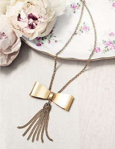 bow tassel necklace.
