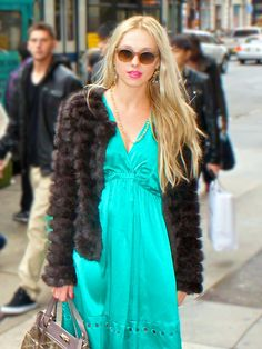 A knitted rabbit fur jacket is lightweight and easily goes with any of your dresses.