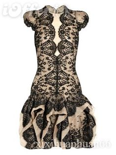 black and nude lace dress with great details / scalloped neckline / interesting skirt