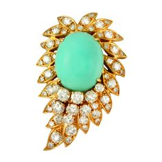 VAN CLEEF & ARPELS. 18K Yellow Gold Brooch with diamonds and a cabouchon oval Turquoise. Diamond total carat weight: 3.70. Circa 1990s