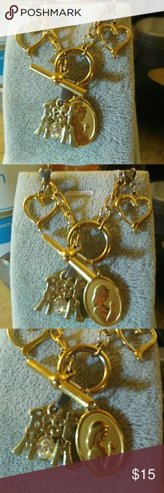"Earrings & Best Mom w/ Praying Mary Charm Necklace Gold tone heart shaped Post back earrings with butterfly backs unsure of the metal content but super cute & anodized aluminum chain with gold tone front drop clasp with Mother Mary religious charm & gold tone Best Mom charm with white CZ inside the letter O.  Chain is 18"" in length with clasp. Independent Jewelry Necklaces"