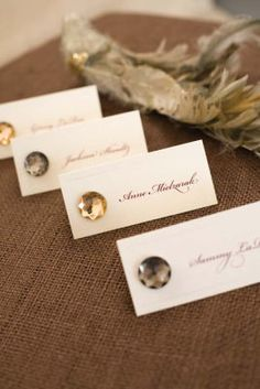 Michaels.com Wedding Department: Romantic Place Card These place cards are simple yet elegant, adorned with a touch of bling. Courtesy of Gartner Studios®