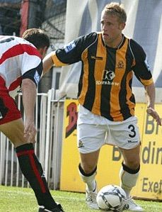 away sponsor, Vandanel. Stephen Reed away at Exeter with striped shirts and white shorts Cambridge United Fc, Striped Shirts, Exeter, Football Shirts, White Shorts, The Unit, Sports, Hs Sports, Football Jerseys