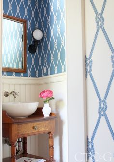 I like the positive/negative wallpaper,  the beadboard wainscoating, and the vanity made from a old piece of furniture.