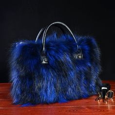 Make sure you get this sapphire blue fox fur large hand bag timeless glamour babes! Available now on our website! Link in bio Also between make sure you use the discount code : FWRECNSMNRWB One limit per customer Fur Purse, Fox Fur, Large Bags, Backpack Bags, Leather Handbags, Leather Bags, Blue Sapphire, Atlanta, Purses