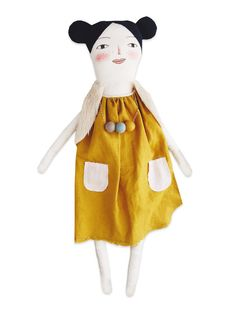 Handmade Doll   Sycamore Street Press This handmade doll from Mer Mag loves to play! She wears a beautiful, mustard dress with pockets and a necklace to match. Spunky pig tails and a furry vest complete heroutfit.— Hand sewn and painted. Made in the USAAt Mer Mag, Merrilee Liddiard lovesto play. And to play creatively at that. You'll find hercreating, celebrating, playing, reading, doing, and wearing anything and all things that inspire her..