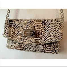 Nine West snake print handbag Snake print, convertible-cross body hand bag || perfect condition || multiple pockets || leather and silver chain strap Nine West Bags Crossbody Bags
