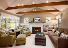 Family Room - contemporary - living room - vaulted ceiling, rustic exposed beams, earthy tones, built-ins, contemporary sofas and chairs, fireplace, bright and airy