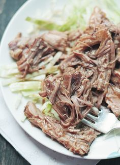 A luscious and flavorful low carb pulled pork recipe that can be made easily in your slow cooker. Keto, Atkins Diet and Paleo friendly recipe.