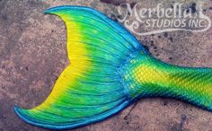 Neon blue, green and yellow silicone mermaid tail by Merbella Studios inc