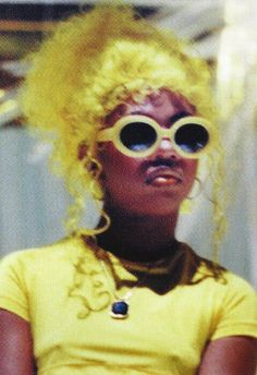 lil kim + yellow everything + 90s throwback
