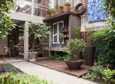 Escritório com jardim e jeito de casa