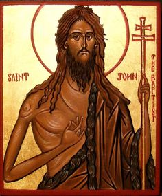 This picture shows Jesus holding a cross  and in the other hand making a gesture showing peace and purity.