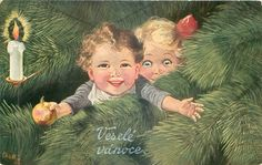 boy reaches front with outstretched arms amongst Xmas tree branches, ornament in one hand, girl behind right