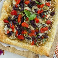 A puff pastry crust topped with caramelized onions, roasted eggplant, kalamata olives, and roasted red peppers. So much deliciousness!
