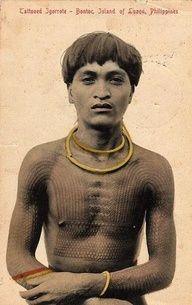 A Kalinga maingor (warrior) with fungana (tree fern) tattoos, ca. 1900