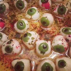 Marinated Eyeballs - marinated mozzarella balls with green & black olives.  Used the recipe at: http://dabbled.org/halloween-food-dots-mozzarella-eyeballs