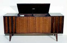 console record players.  The record player was down inside and you reached it from the top.